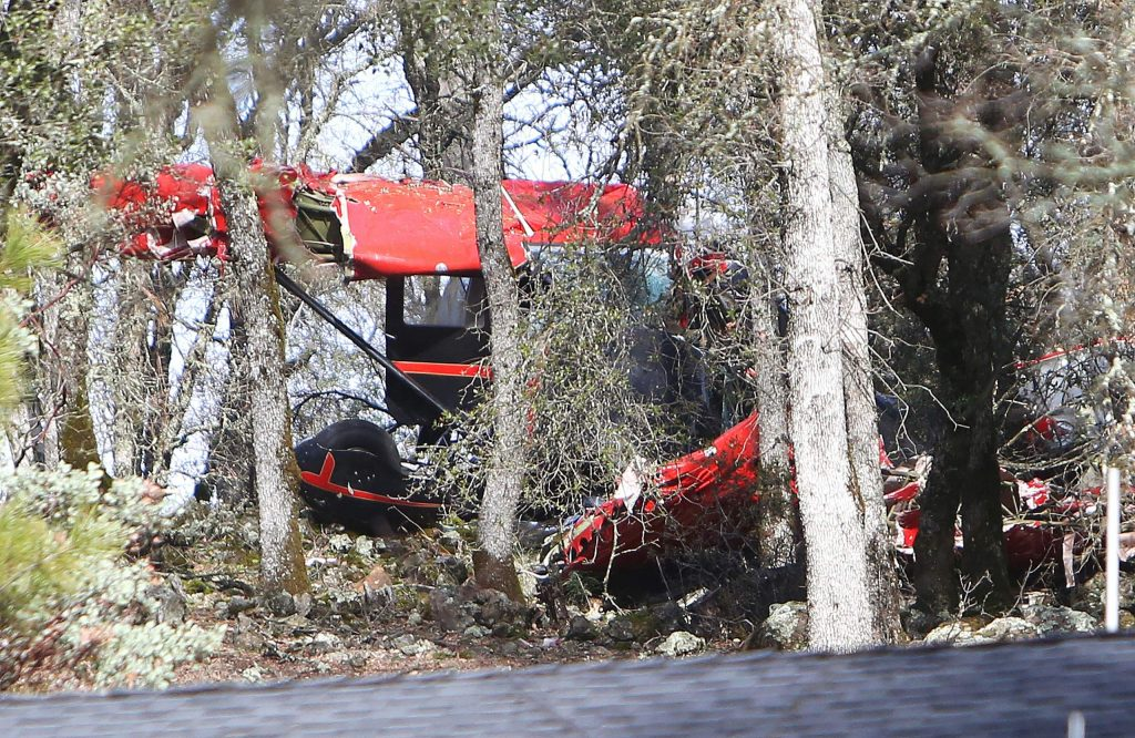 The mangled wings, fuselage, and landing gear of a single-engine airplane lies scattered Friday morning among a grove of oak trees near Dry Creek and Haines roads, near Auburn's airport. Two of the three occupants died as a result of the wreck.