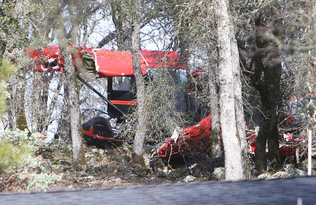 The mangled wings, fuselage, and landing gear of a single engined airplane lies scattered among a grove of oak trees near Dry Creek Road and Haines Road near the city of AuburnÕs municipal airport Friday morning. Two of the three occupants died as a result of the wreck.