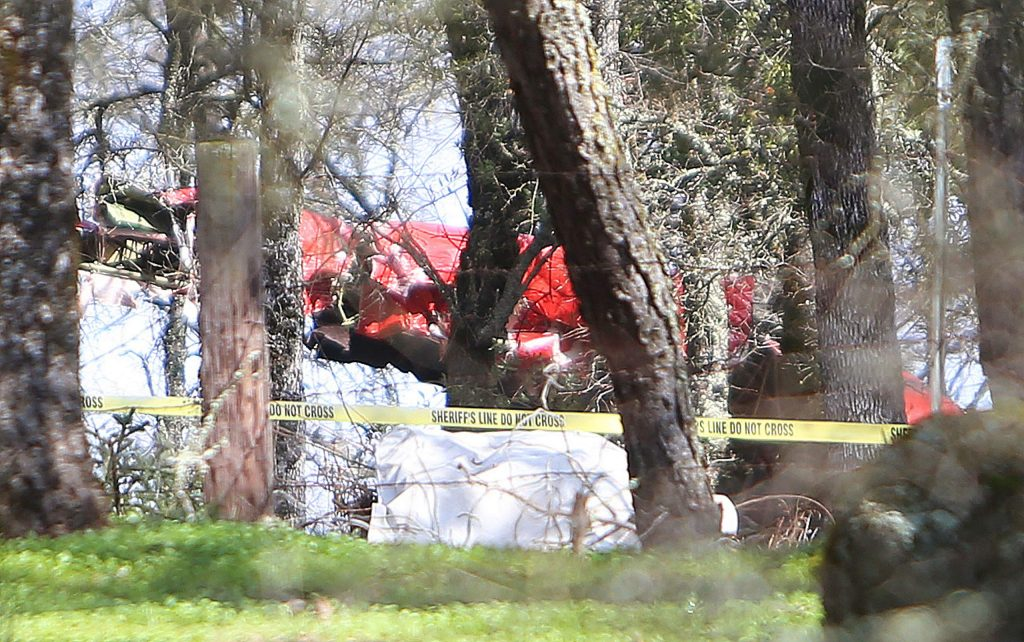 Sheriff's tape surrounds the wreckage of a plane that crashed outside of the Auburn airport Friday morning. It was unknown whether the plane was taking off or landing.
