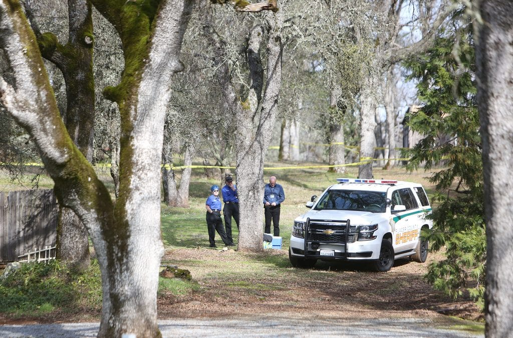 Plane wreckage scattered over a large wooded area is surrounded by police tape off of Dry Creek Road near Haines Road in Auburn where two people died.