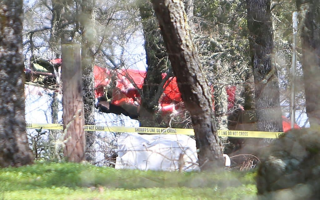 Sheriffs tape surrounds the wreckage of a plane that crashed outside of the Auburn airport Friday morning killing two of its three passengers. It was unknown whether the plane was taking off or landing.