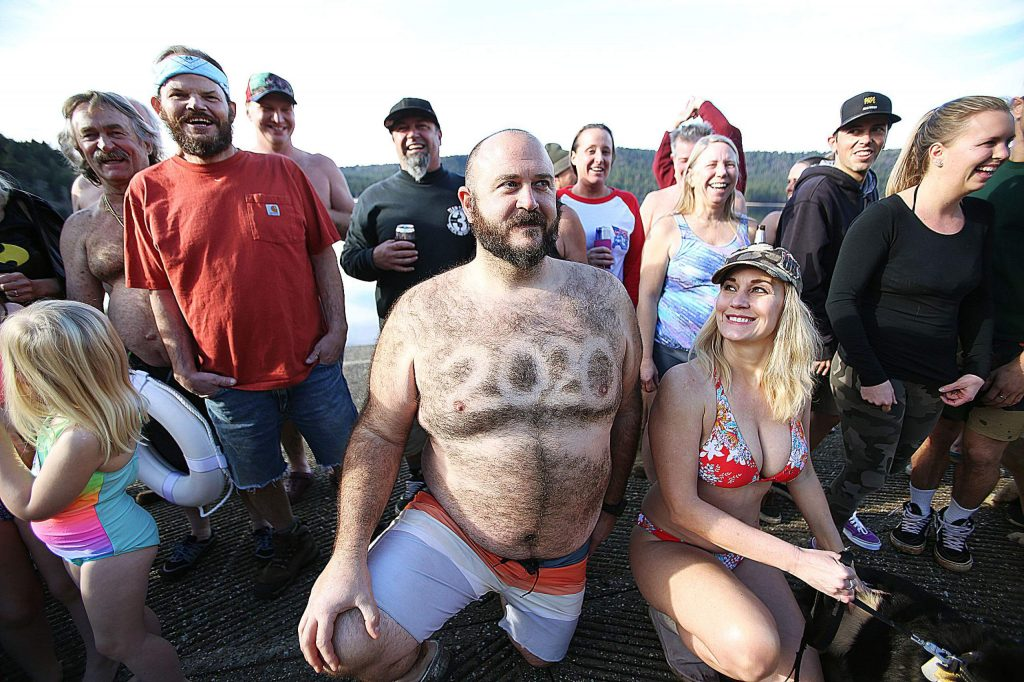 People decorated themselves before taking the icy plunge into Scotts Flat Lake Wednesday afternoon.
