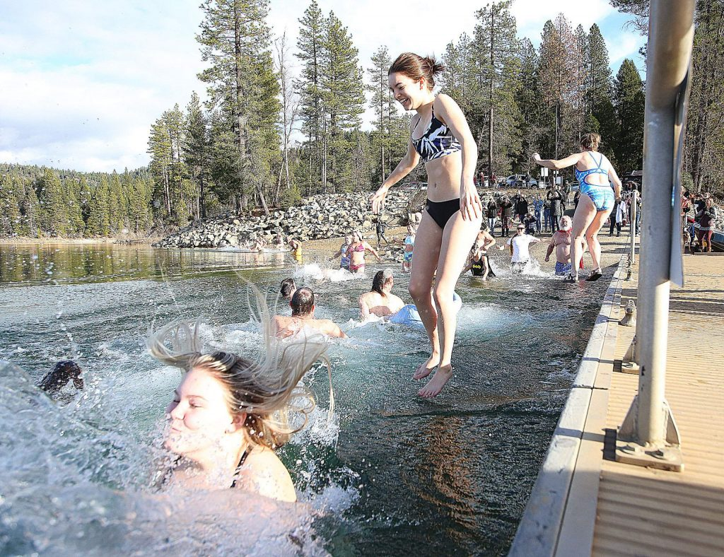 About 40 polar plunge participants jumped into Scotts Flat Lake during the New Year's Polar Plunge.