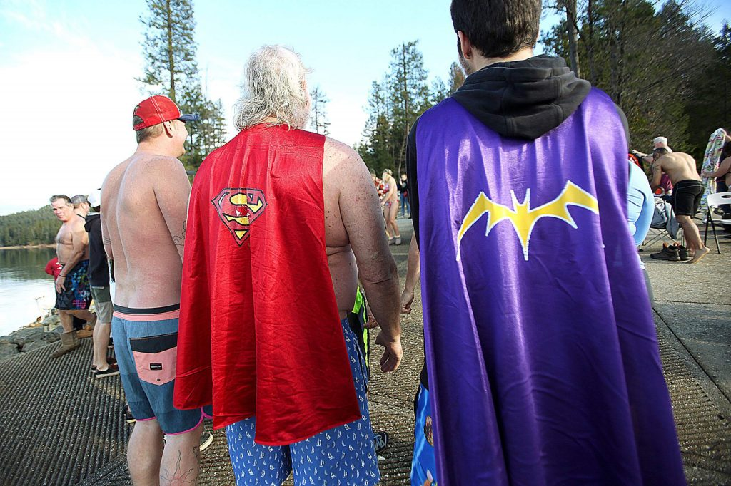 Some Polar Plunge participants had to evoke their super powers prior to entering the frigid waters of Scotts Flat Reservoir for the New Year's dip.