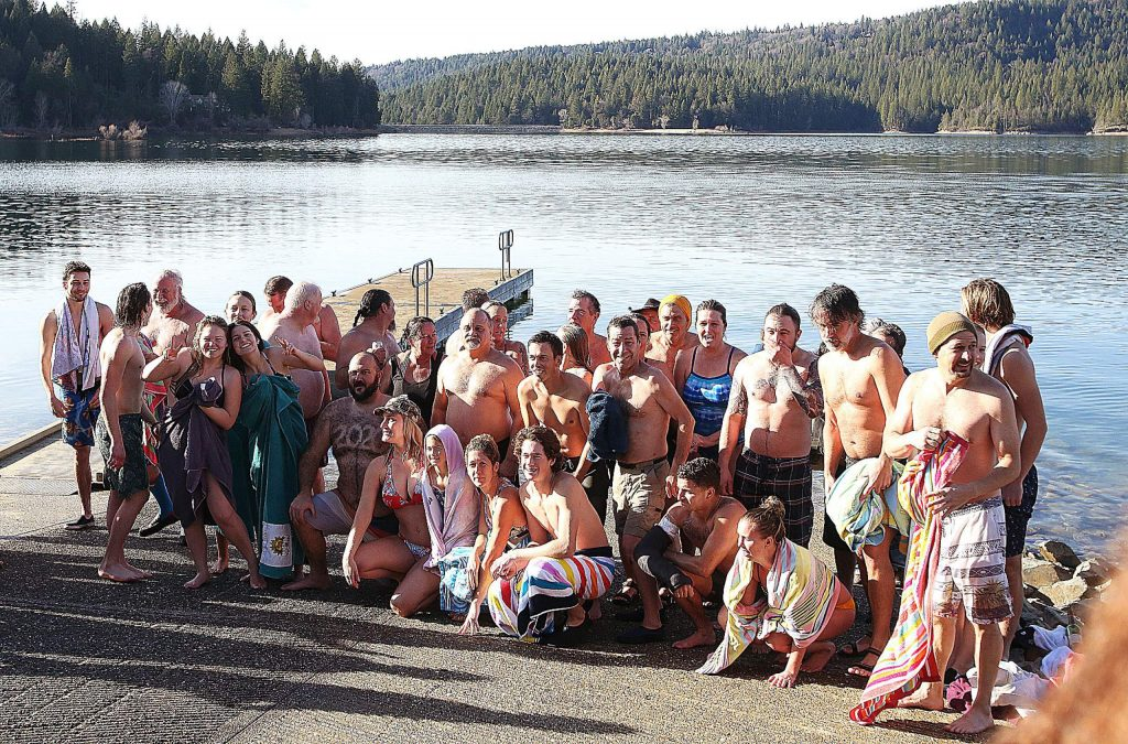 Polar Plungers pose for a photo after taking the dip into Scotts Flat Reservoir.