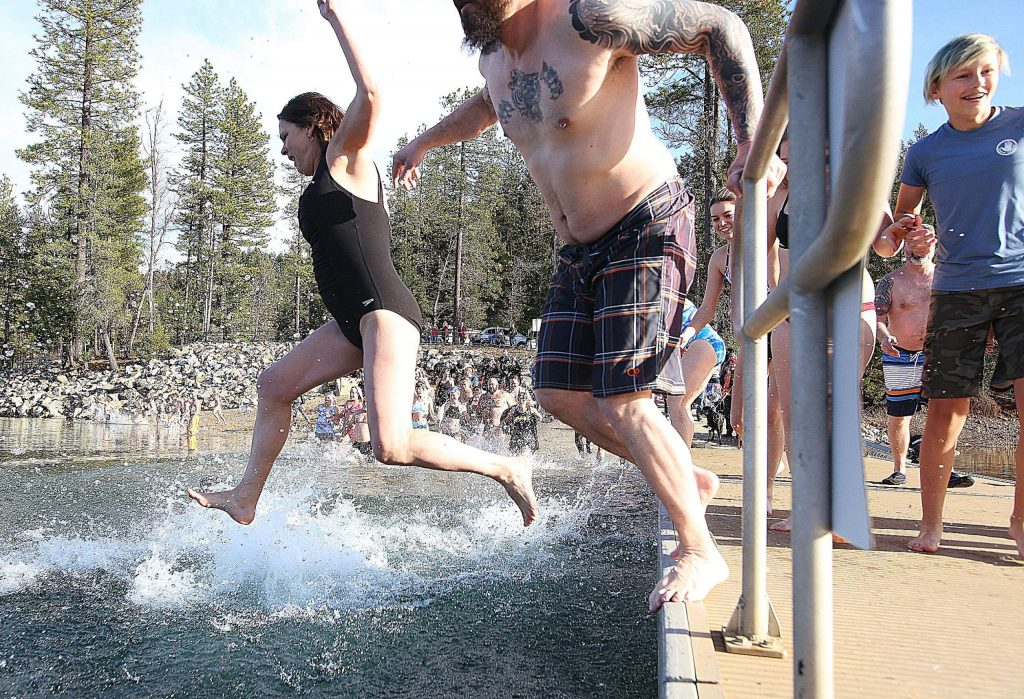 About 40 brave souls took to the chilly waters of Scotts Flat Lake for the annual Polar Plunge which is becoming a regular tradition for some area residents for New Year's Day.