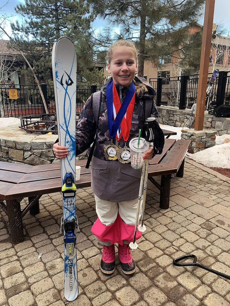 Kaya Russell poses with the medals she earned at a recent Farwest event held at Northstar. Russell, 13, has shined in moguls events since joining the Squaw Valley Freestyle Ski Team four years ago.