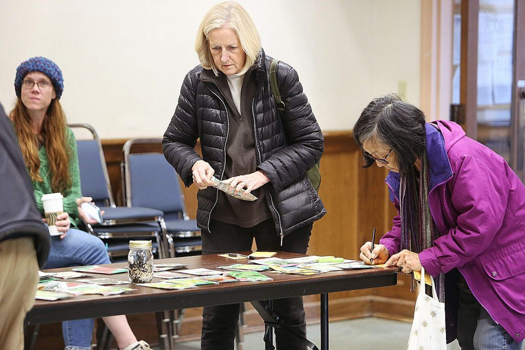 Seed swappers were eager to collect as many different varieties of fruits and vegetable seeds made available Saturday at the Madelyn Helling Library in Nevada City.