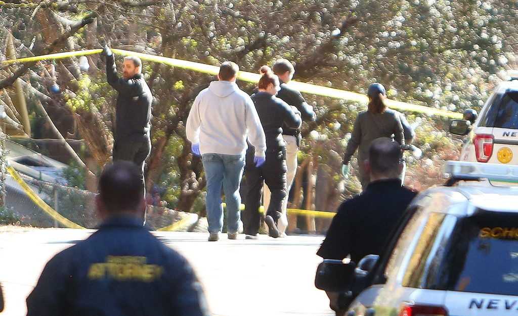 Law enforcement personnel in this file photo continue their investigation into the officer-involved fatal shooting at Oak Street and Walker Drive. The incident occurred New Year's Day.