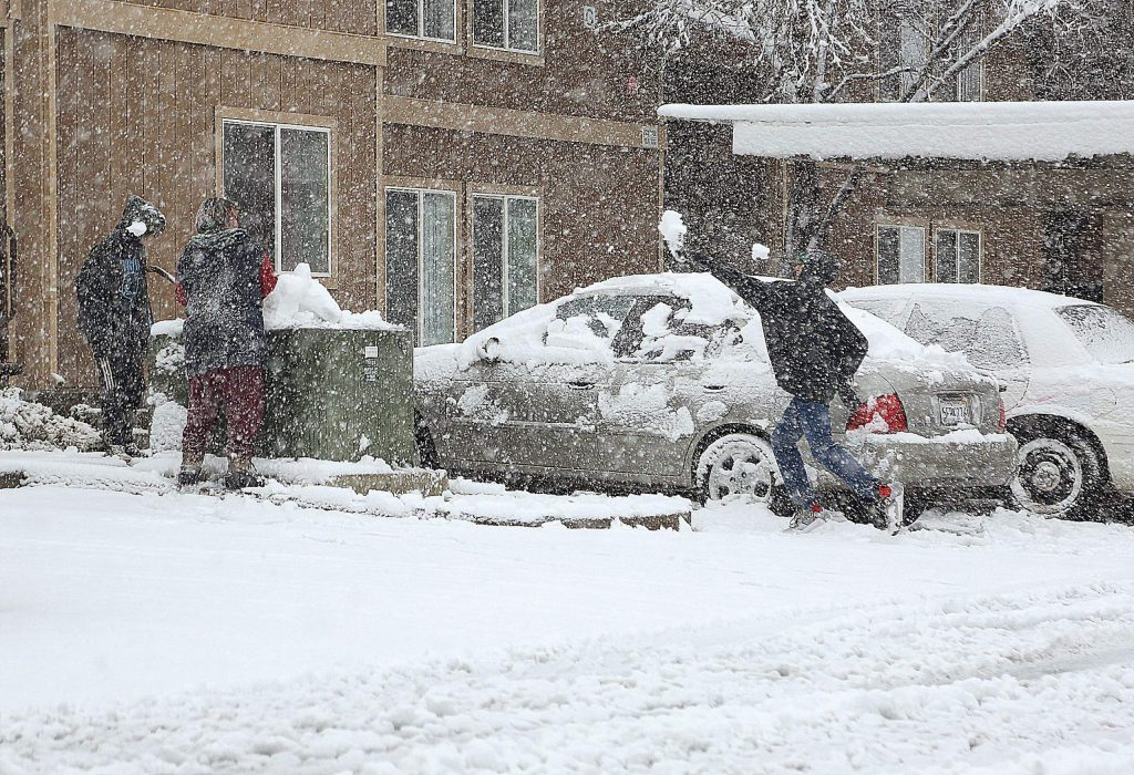 Fresh snow provides opportunity for a snow ball fight at the Glenbrook Basin apartments Thursday.