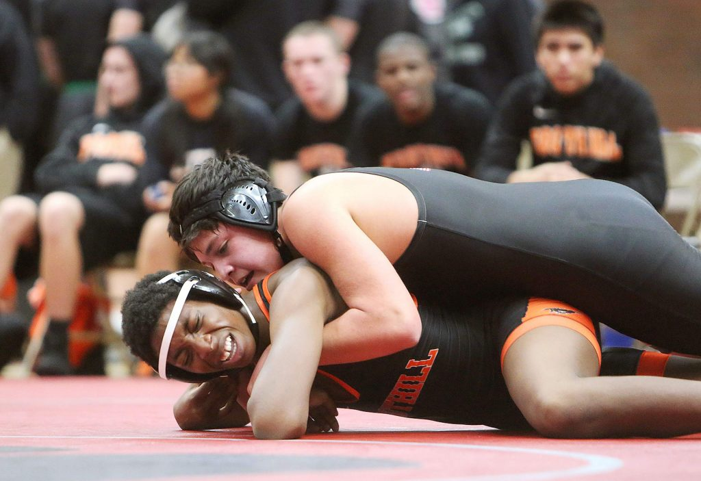 Bear River's Gabe Ellis wears down Foothill High School's Ed Marshall in the 172 pound match. Ellis won by decision.