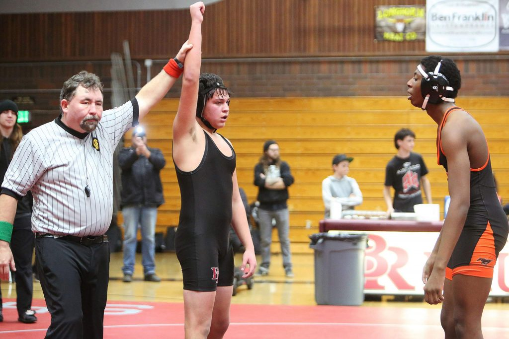 Bear River's Gabe Ellis is declared the winner against Foothill High School's Ed Marshall in the 172 pound match.