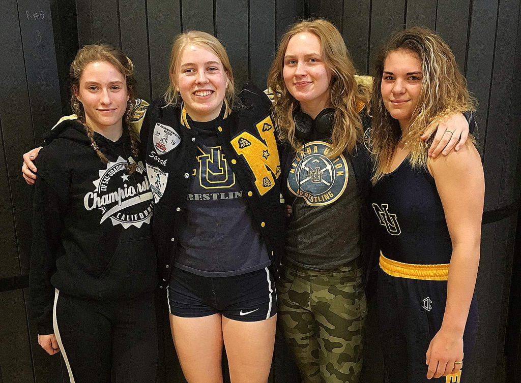 Nevada Union wrestlers (from left) Mackenzie Morgan, Sarah Skotnicki, Myra Walker and Amanda Beall have regularly medaled at tournaments this season.