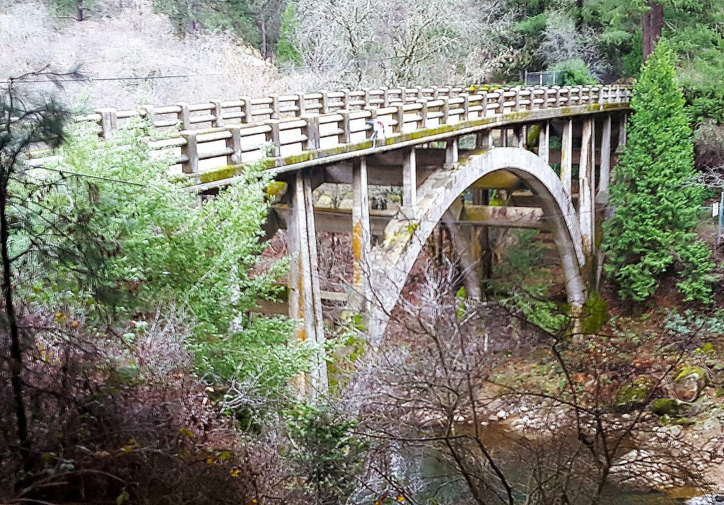 The old bridge spanning the Bear River below Highway 174 arches above the slow-moving waterway Monday afternoon ahead of a set of big storms later this week.
