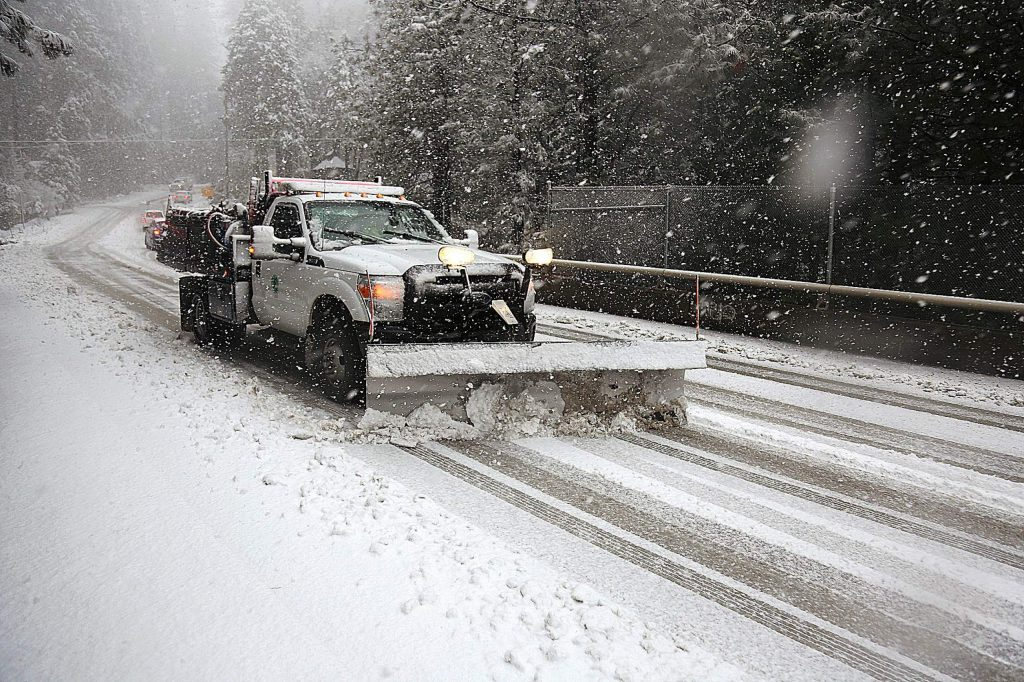 A Nevada County snowplow makes its way along Banner Lava Cap Road at Old Tunnel Road Thursday morning.