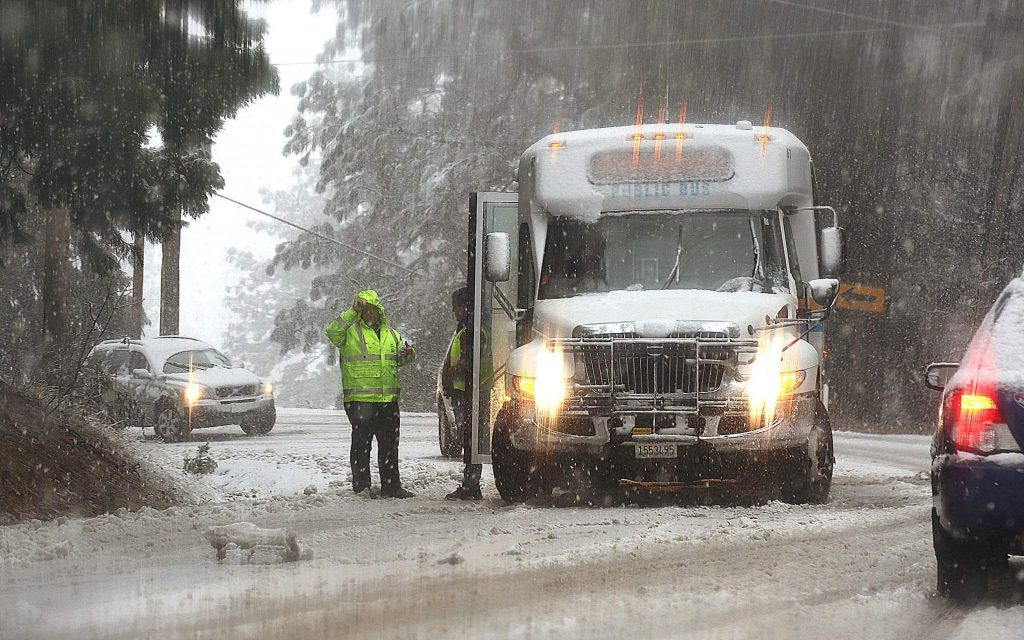 A Gold Country Stage bus stalls in the middle of Old Tunnel Road during Thursday's snow.