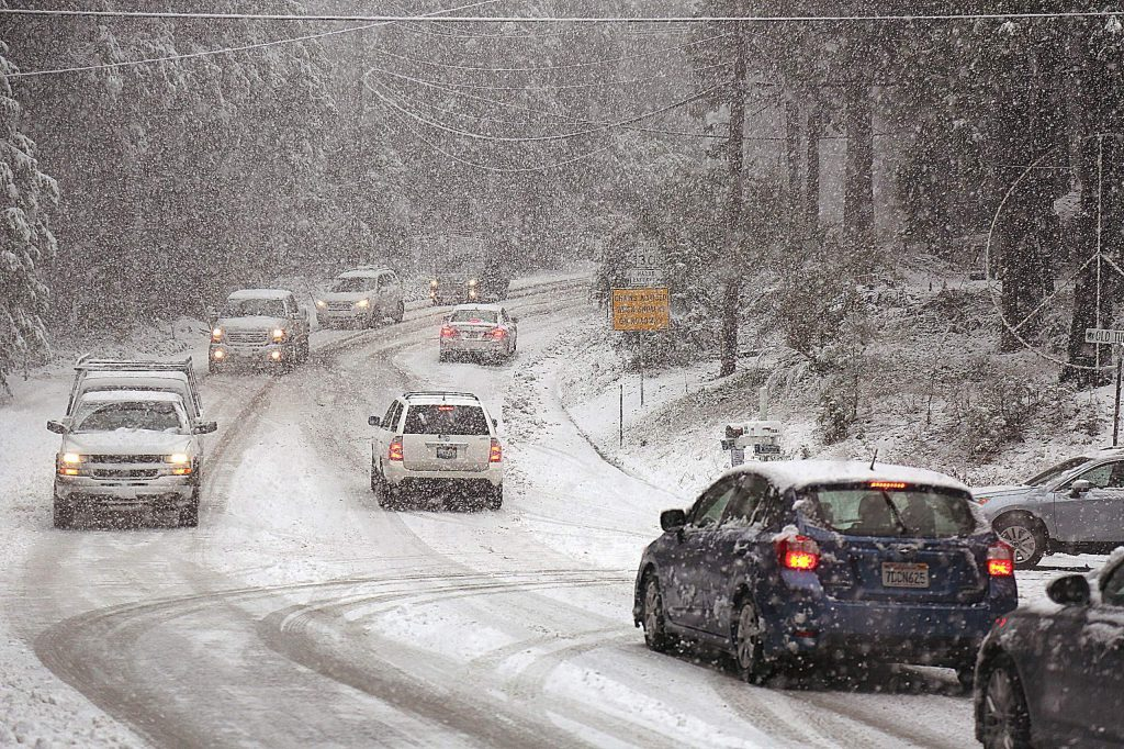Vehicles turn around at Old Tunnel Road at Banner Lava Cap Road during the low Thursday snow.