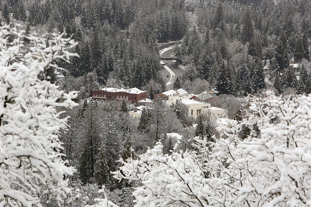 The National Exchange's new paint job stands out along Broad Street in a Nevada City shrouded in snow Thursday afternoon as viewed from Sugarloaf Mountain.