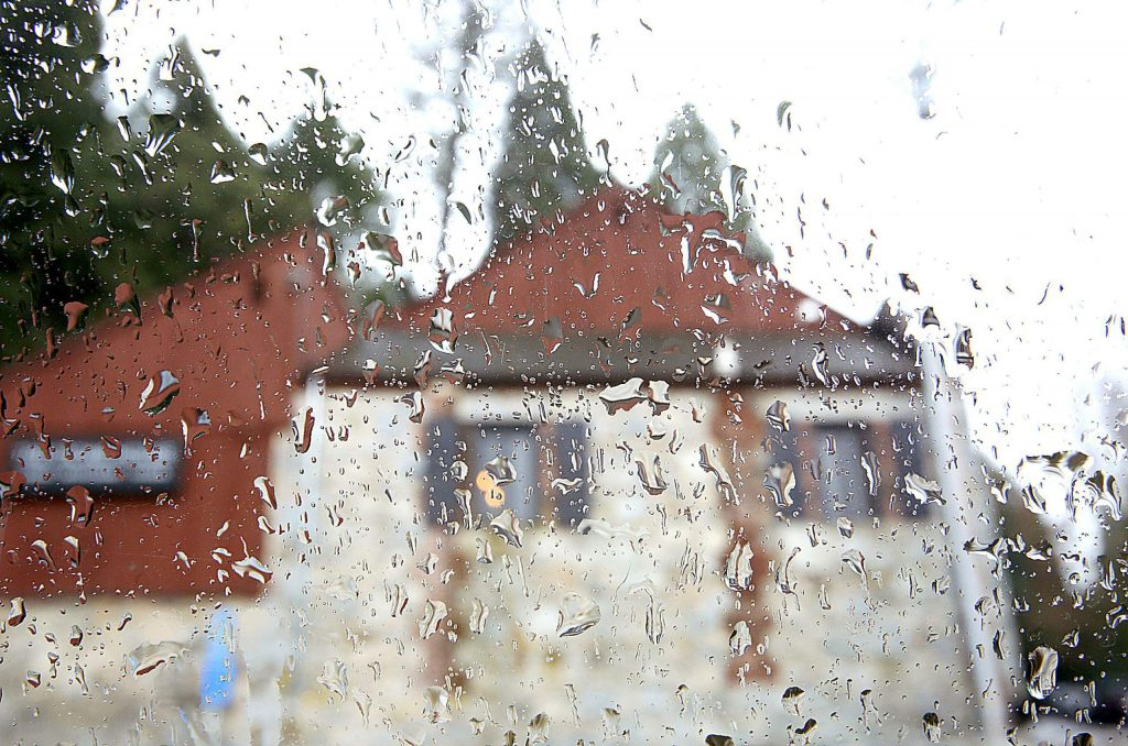 Rain drops gather on the window of a vehicle outside of The Stone House in Nevada City during Tuesday's rain.