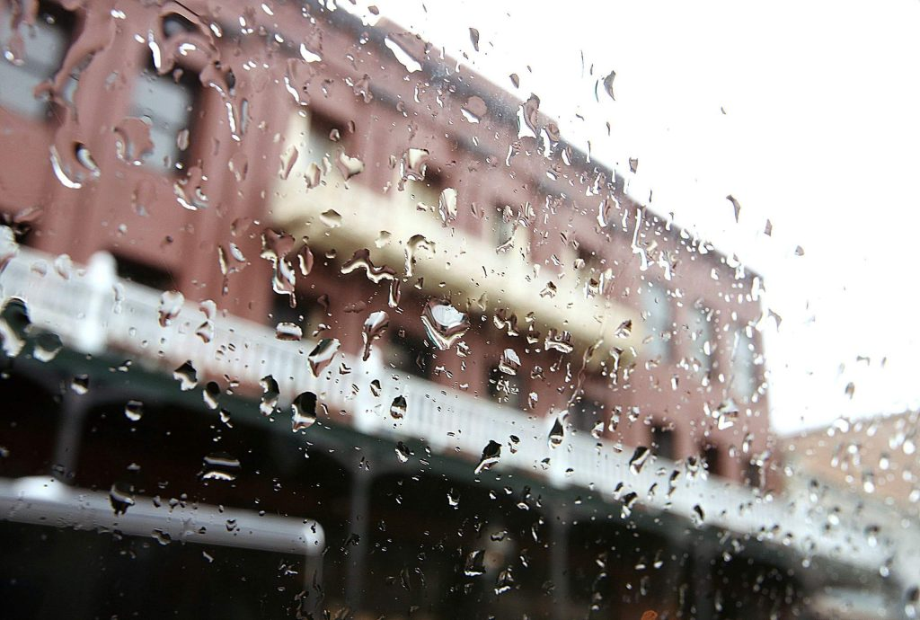 Rain drops gather on a windshield near the National Exchange Hotel off Broad Street Tuesday. A quarter- to a half-inch of rain was forecast through Tuesday night.