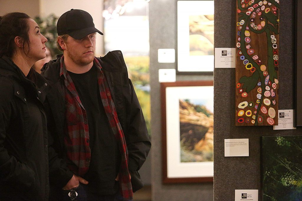 People check out the 2020 Wild and Scenic Art Show, juried by Nashormeh N. R. Lindo, William L. Fox, and Michael Llewellyn.