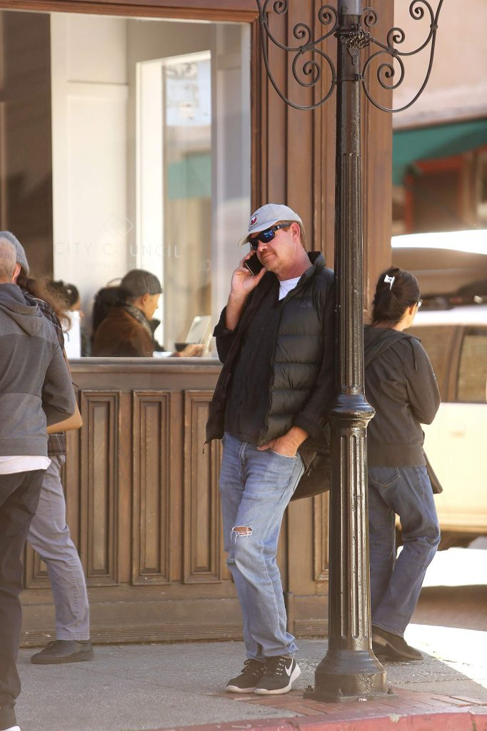 A cellular phone user steps outside of City Council coffee shop in downtown Nevada City to make a phone call.