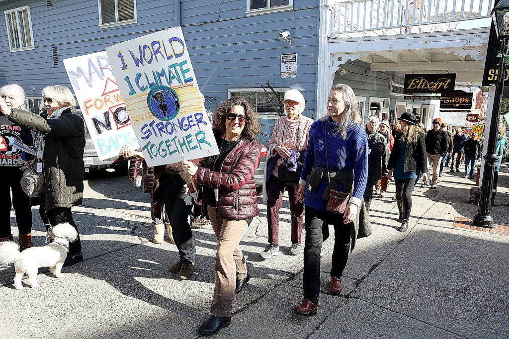 Dozens of people took to the streets of downtown Nevada City Saturday afternoon to take part in the 4th annual women's march.