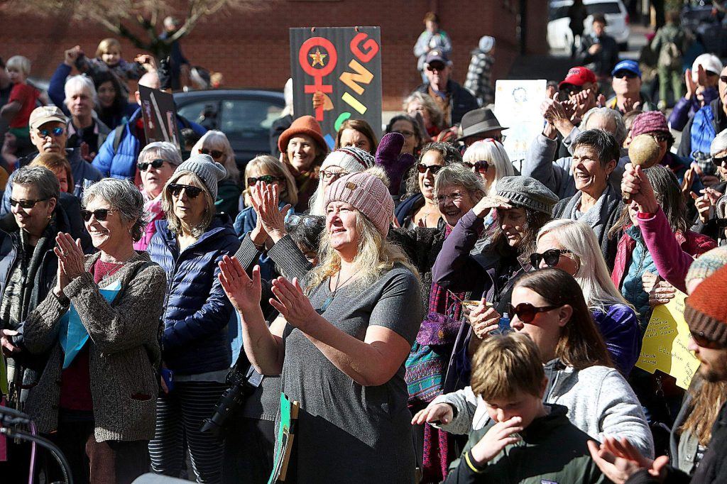 About 100 people gathered in downtown Nevada City to take part in the annual women's march.