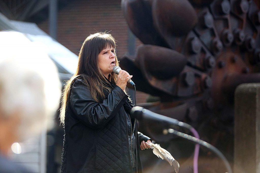 Shelly Covert, Executive Director of CHIRP and Tribal Spokesperson for the Nevada City Rancheria, welcomes women's march participants Saturday in Nevada City.