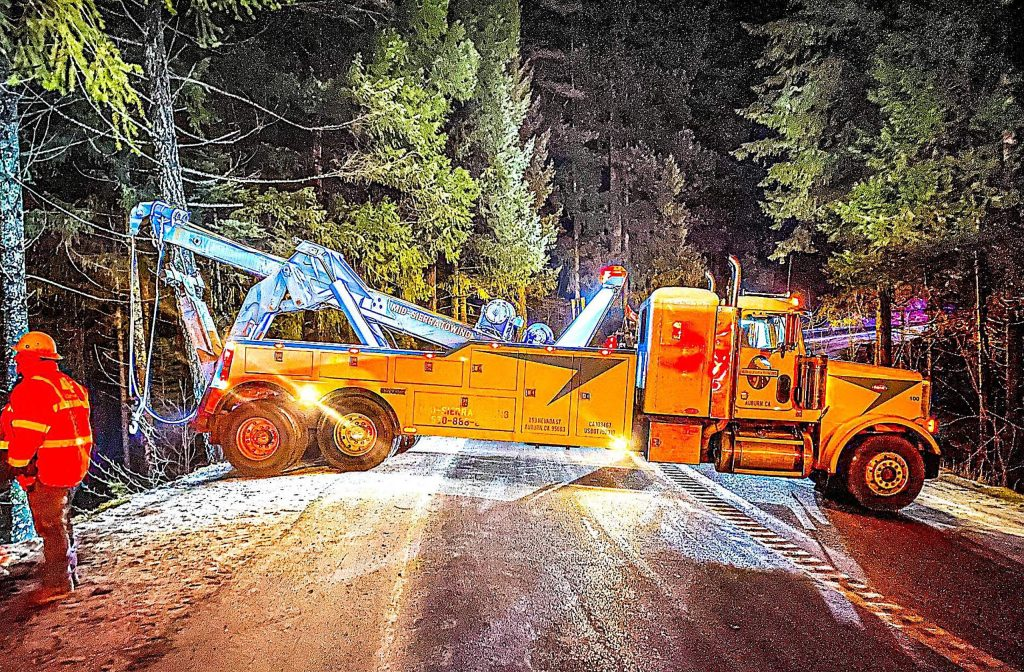 A tow truck worked late into the night to pull a big rig up a cliff back onto Highway 20 after an accident Monday afternoon.