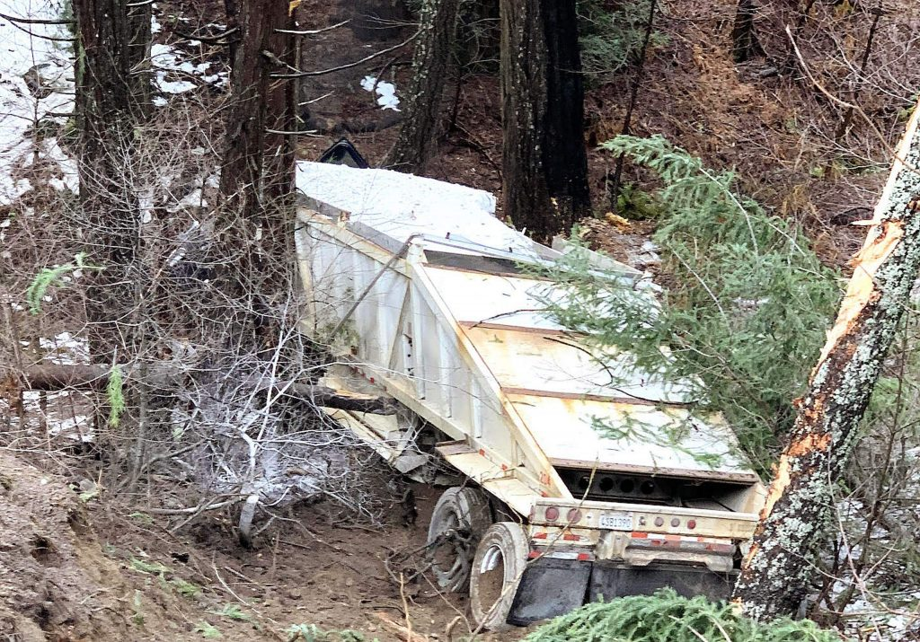 A big rig was pushed off the road and down a cliff on Highway 20 near White Cloud campground Monday.
