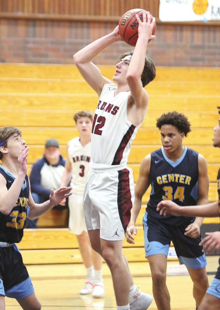 Bear River senior Justin Powell (12) pulls up in the paint during Wednesday evening's league matchup against the Center High Cougars.
