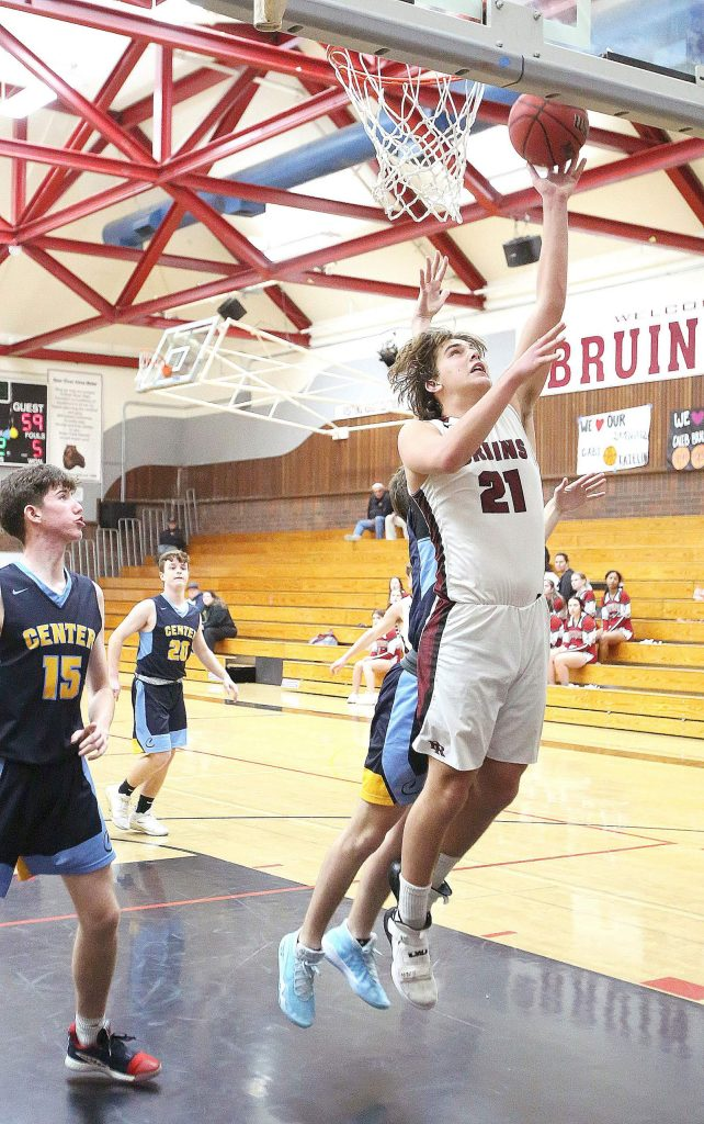 Bear River sophomore Harrison Alexander (21) makes a lay up for two points during the Bruins matchup against Center Wednesday at home.