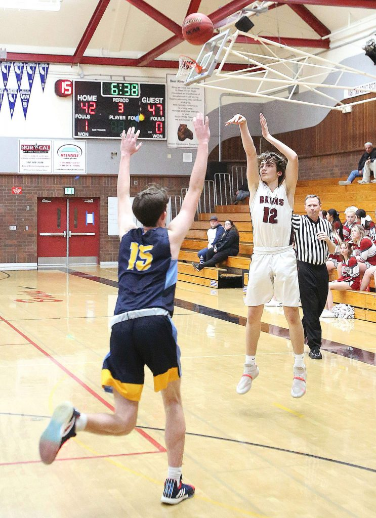 Bear River senior Justin Powell lets a three point shot fly during Wednesday's league loss to the Center Cougars. He made 5 three pointers during the game.