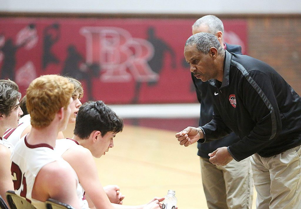 Bear River boys basketball varsity head coach Ralph Lewis talks to his team during a time out.