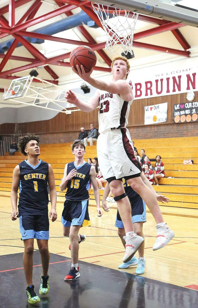 Bear River senior Bradley Smith (23) attacks the basket with a reverse lay in good for two points during second half game play against the Center High School Cougars. Smith finished with 12 points.