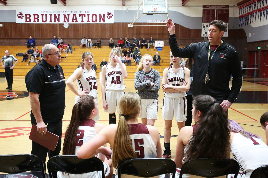 Bear River varsity girls head coach Jeff Bickmore talks to his team during a timeout against Center High School Tuesday evening at home.