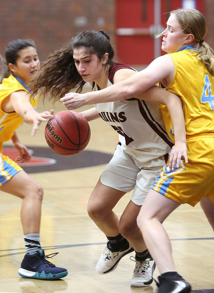 Bear River junior Erika Junge (21) pushes through a pair of Center High School defenders during Tuesday's home game.
