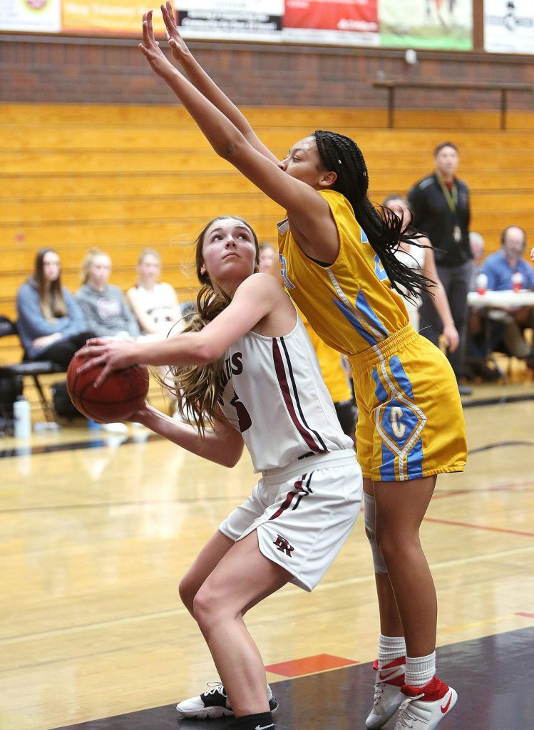 Bear River freshman Kaylee Vieira (15) looks to put up a pair of points during Tuesday night's win over league rival Center High School.