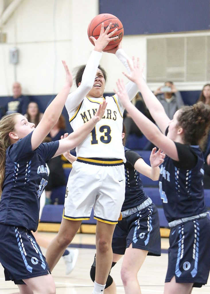 Nevada Union junior Aijah King (13) pulls up for two of her twenty-two points during Tuesday's matchup against Oakmont.