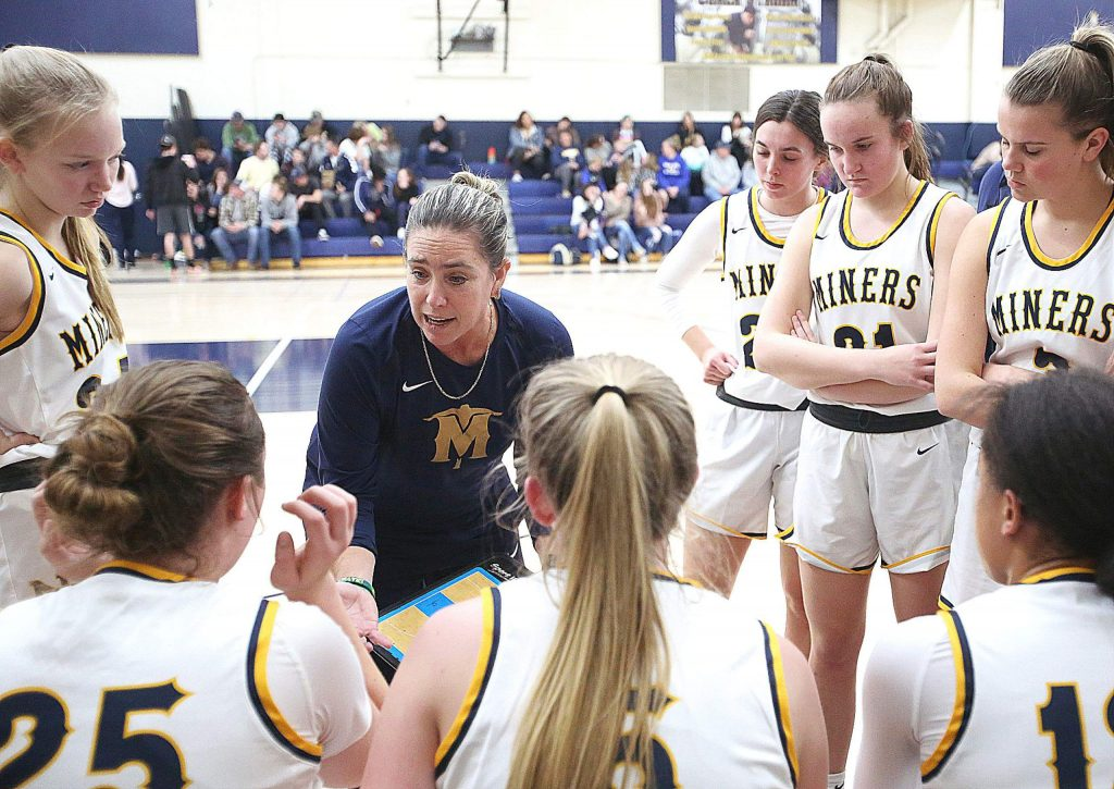 Nevada Union Lady Miners varsity head coach Jenn Krill talks to her team during a timeout against Oakmont Tuesday at home.
