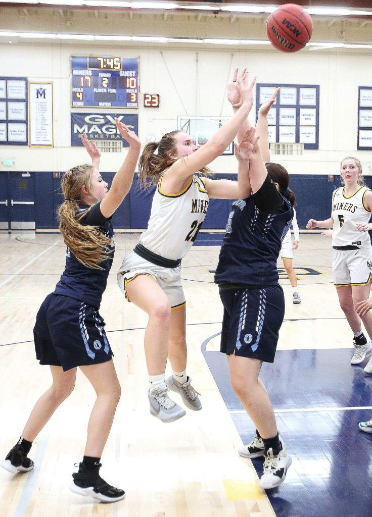 Nevada Union junior Sky Harmon (21) lets a two pointer fly to help put the Lady Miners up 19-10 during first half game play against Oakmont Tuesday. Oakmont would close Nevada Union's early lead to tie the Miners 24-24 at the half before closing them out 54-43.