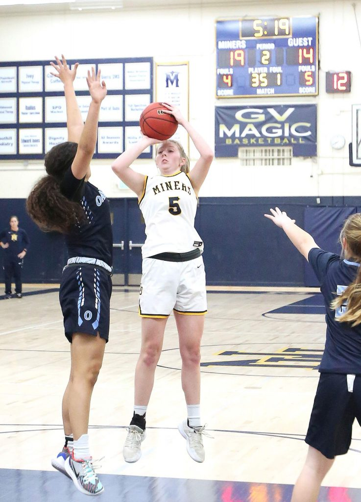 Nevada Union senior Emerson Dunbar (5) lets a pull up jumper fly from the free point line Tuesday against the Oakmont Vikings.