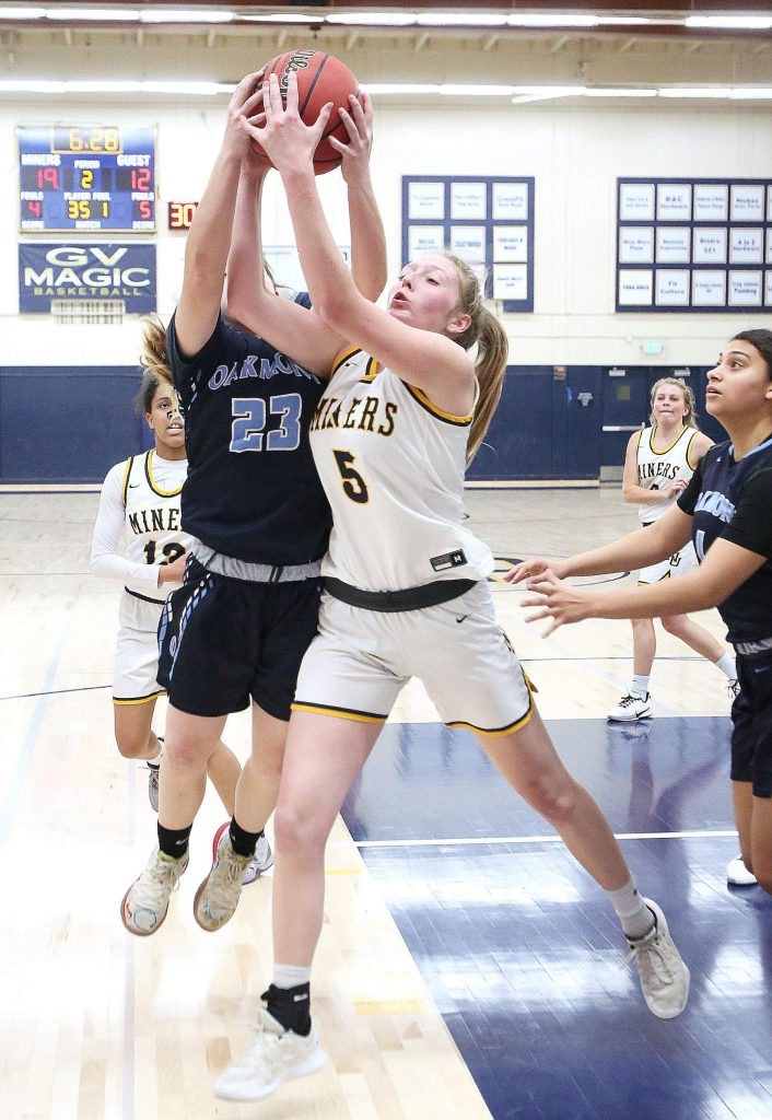 Nevada Union's Emerson Dunbar gets physical as she vies for possession of the ball against Oakmont's Maddison Redinger (23) Tuesday at home.