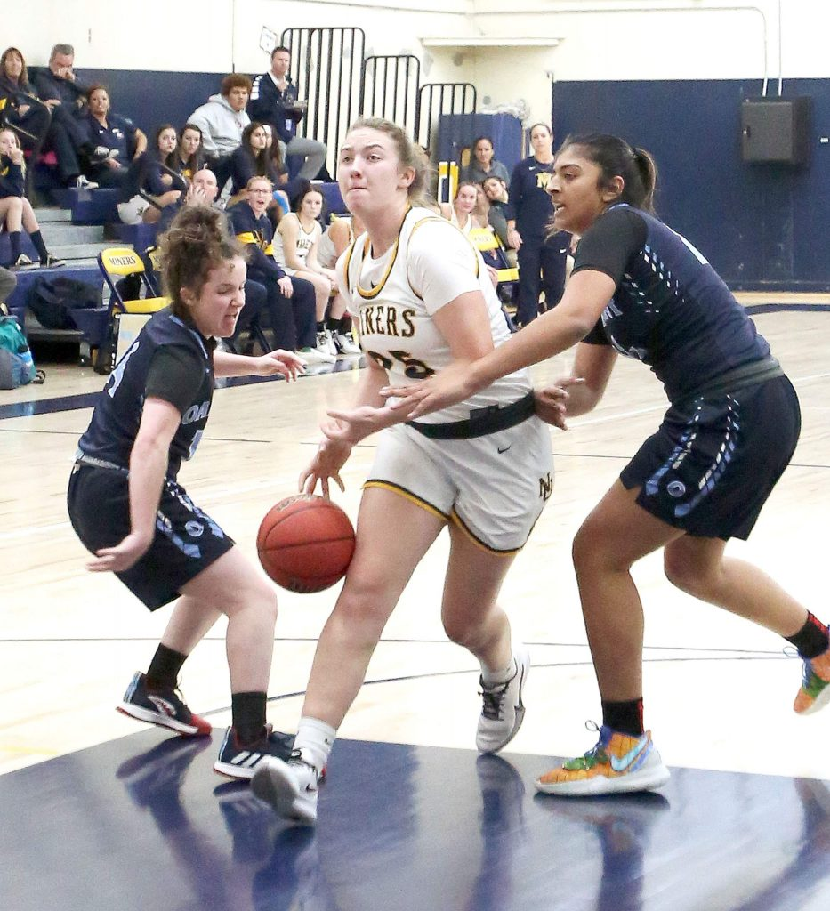 Nevada Union senior Kendall Hughes (25) drives to the basket through the Oakmont defense during Tuesday's home matchup.