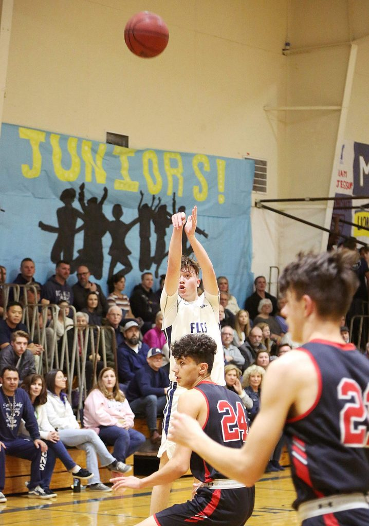 Forest Lake Christian's Luke Gilliland sinks a deep shot against the Knights during Friday night's homecoming game.