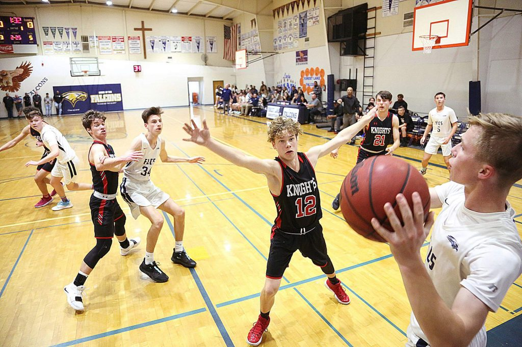 Forest Lake Christian's Simon Blackburn looks to inbound a pass during Friday's game against the Futures Knights.