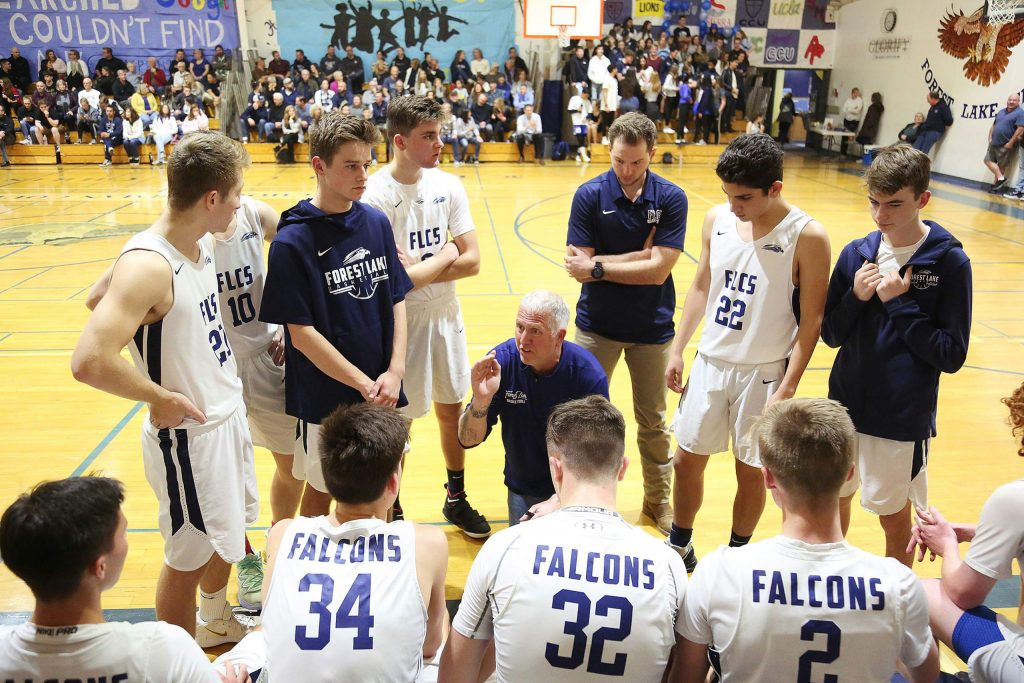 Forest Lake Christian varsity boys head coach Derek Gilliland talks to his team during a time out on the sidelines during Friday's homecoming game against Futures.
