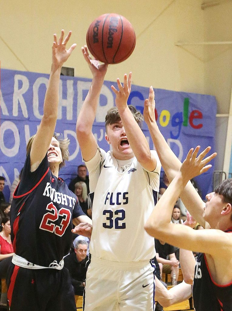 Forest Lake Christian's Luke Gilliland pulls up for a jump shot during Friday's homecoming game against the Futures High School Knights.