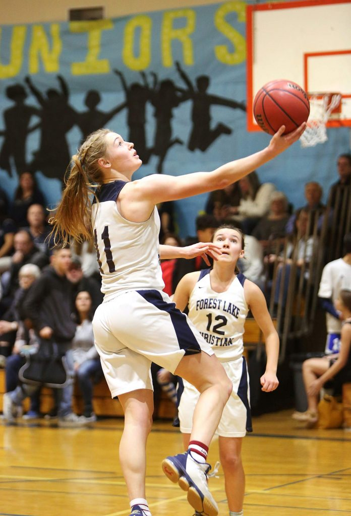 Forest Lake Christian senior Amber Jackson (11) scores two of her game-high 20 points during Friday's homecoming win against the Futures Knights.